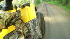 Wheel ATV drives into a deep mud puddle - stock footage