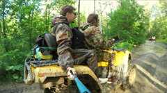 Two Man on ATV in forest video Selfe - stock footage