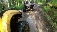 Wheel ATV drives into a deep mud puddle Stock Footage