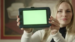 Seller shows touchpad with green screen on camera in furniture shop Stock Footage