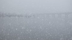 Snowfall on the river Stock Footage