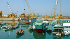 Homes of Chinese boat people, moored together in Hong Kong Stock Footage