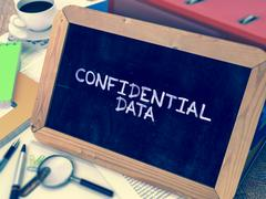 Confidential Data - Chalkboard with Hand Drawn Text Stock Illustration