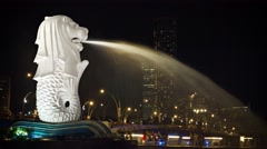 Merlion fountain is Singapore icon that is half-fish and half-lion Stock Footage