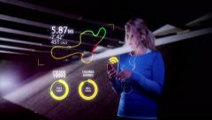 Attractive female runner using fitness tracker & heart rate monitor app. Stock Footage