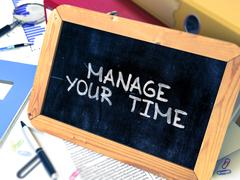 Manage Your Time. Motivational Quote on Small Chalkboard Stock Illustration