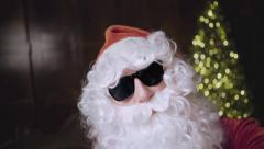 Santa Claus in sunglasses dancing, smiling and making selfie photo  Stock Footage