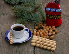 Coffee, gift bag, forest nutlets, linking of cookies and fir-tree branch Stock Photos