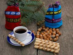 Blue and red gift bag, coffee, forest nutlets, linking of cookies and fir-tre Stock Photos