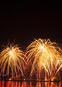 Volleys of beautiful fireworks in the night sky - stock photo