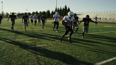 A football player makes a touchdown in slow motion - stock footage