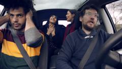 Two men bored of women talking in car Stock Footage