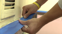Person placing painters tape - stock footage