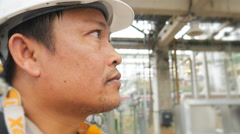 Head shot of engineering in refinery plant Stock Footage