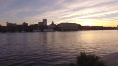 Aerial Shot Moving Quickly Across River to Savannah Waterfront Stock Footage