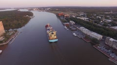 Aerial Shot of Barge and Boat on Way Out of Savannah Riverfront Stock Footage