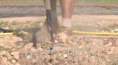 Raking rocks Stock Footage