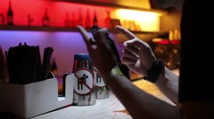Man orders a drink at the bar Stock Footage