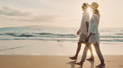 Sunset Walk on a Luxury Beach. Happy Retired Couple on Tropical Vacation. Stock Footage