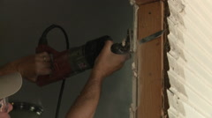 Worker cutting drywall - stock footage