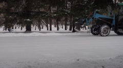 The big tractor removal snow in park Stock Footage