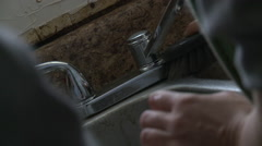Scrubbing Dirty Sink - stock footage