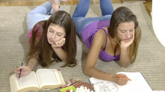 Two teenagers tired of studying at home - stock footage