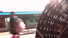Stopping at train station in India people get off with baskets - stock footage
