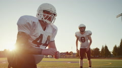 Close up of a football player kicking the ball toward the goal posts - stock footage