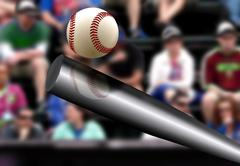 Baseball bat hitting ball with spectator background Stock Photos