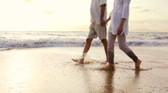 Sunset Walk on a Luxury Beach. Happy Retired Couple on Tropical Vacation. - stock footage