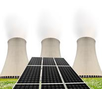 Solar energy panels before a nuclear power plant Kuvituskuvat