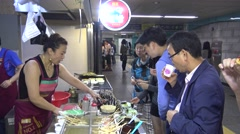 Korean Street Foods oden ingredients, people eat fish cakes and other snack-Dan Stock Footage