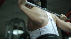 Male athlete powerlifter in the belt for discharge back in the gym at the front Stock Footage