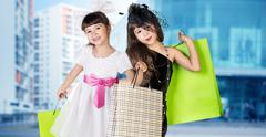Cute little girl in big wear with packages Stock Photos