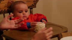 A baby boy eating his birthday cake with his family Stock Footage