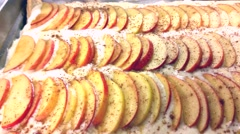 Chef baker making apple pie, in a gn casserole, at a restaurant kitchen Stock Footage