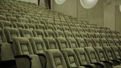 Empty rows of theater, concert hall or movie seats - stock footage