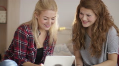 4K Teenage girls in bedroom making a video call on computer tablet Stock Footage