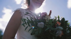 The bride standing with bouquet of flowers. Stock Footage
