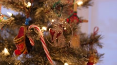A dolly shot of beautiful Christmas ornaments on tree Stock Footage