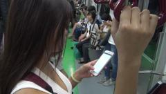 Stock Video Footage of 4K Asian woman using smartphone in subway to do quick text messaging, Korea-Dan