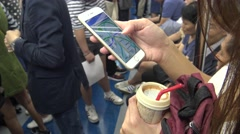 4K Asian woman using smartphone in subway cheack the metro maps of Korea-Dan - stock footage