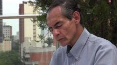 Man Reading in Urban Area Stock Footage