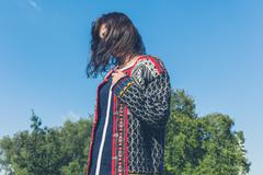 Woman wearing knitted jumper in the park Stock Photos