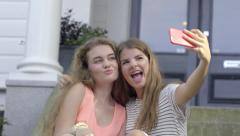 Teen Girls Sit On Front Porch And Take Fun Selfies Together Stock Footage