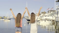 Carefree Teen Girls Hold Hands And Raise Their Arms In The Air Stock Footage