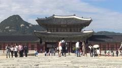 Stock Video Footage of 4K Tourits Visit Geunjeongjeon Hall, entrance of Gyeongbokgung Palace, seoul-Dan