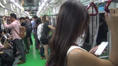 Stock Video Footage of 4K Korean people travel in Subway, travelers using smartphone and talking-Dan
