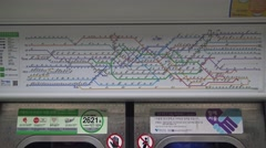 4K Signal the map metro Seoul inside the Subway whit travelers during trip -Dan Stock Footage